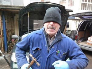 Our Grumpy Old Mechanic, looking as miserable as sin. It's being so cheerful that keeps him going!