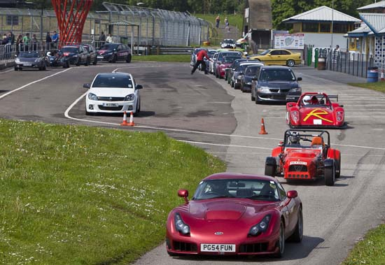Anticipation, exhilaration, the sound of engines being exercised, and the satisfaction of being able to get the best out of a car – all to be enjoyed at track day events like this one at the Castle Combe circuit in Wiltshire.
