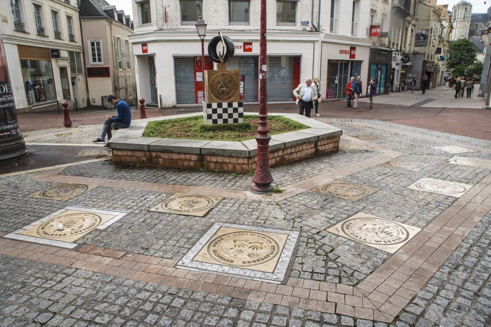 Plaques with winning driver handprints in Le Mans town.