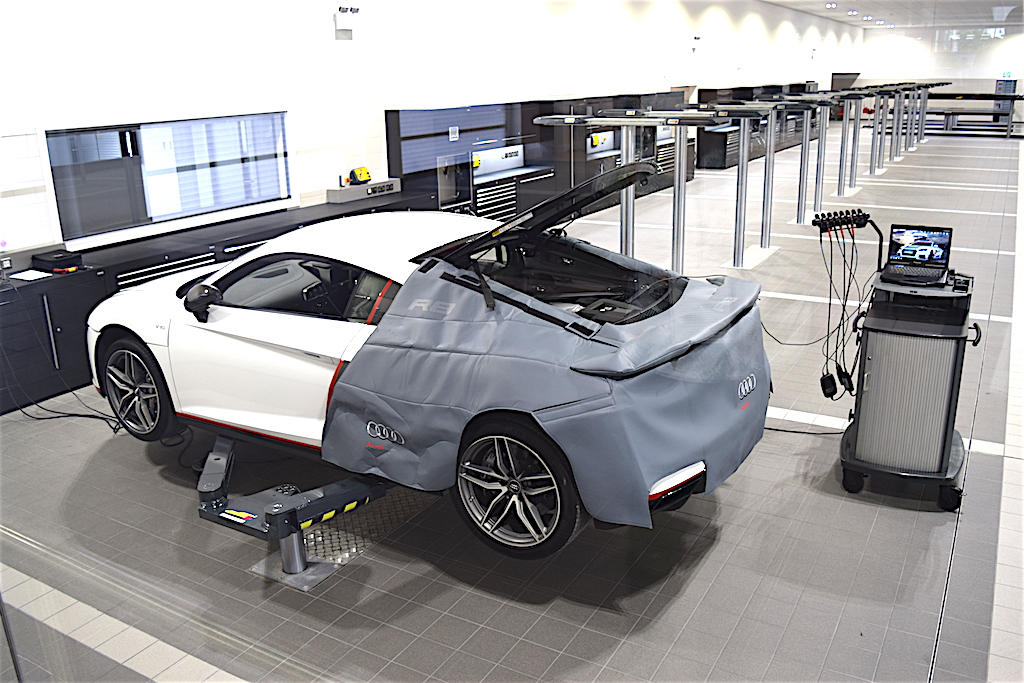 An Audi R8 is seen here in the 24 bay servicing centre at Poole Audi's new premises.