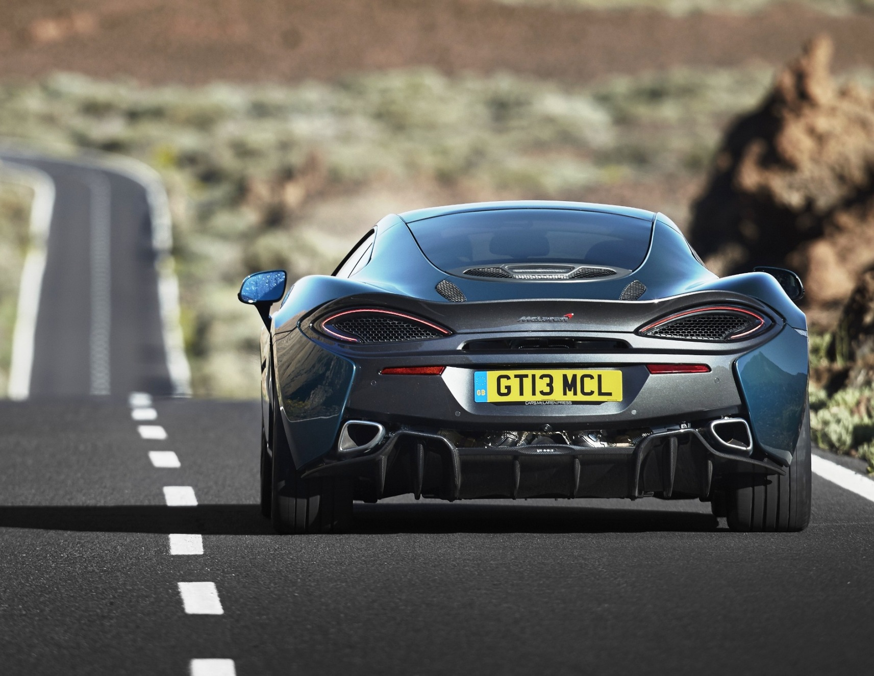 mclaren-570gt-rear-view-action