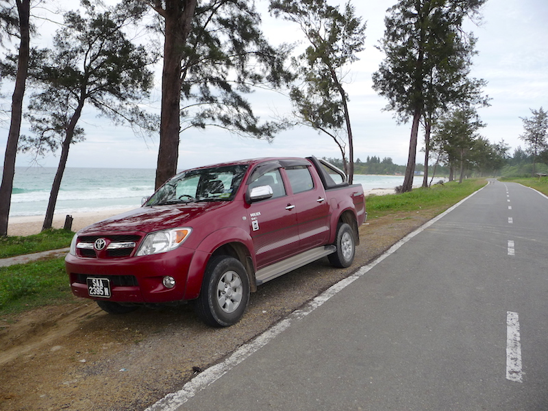 'Our' Toyota, pictured when pausing at the edge of the South China Sea near the Tip of Borneo (we paddled here).