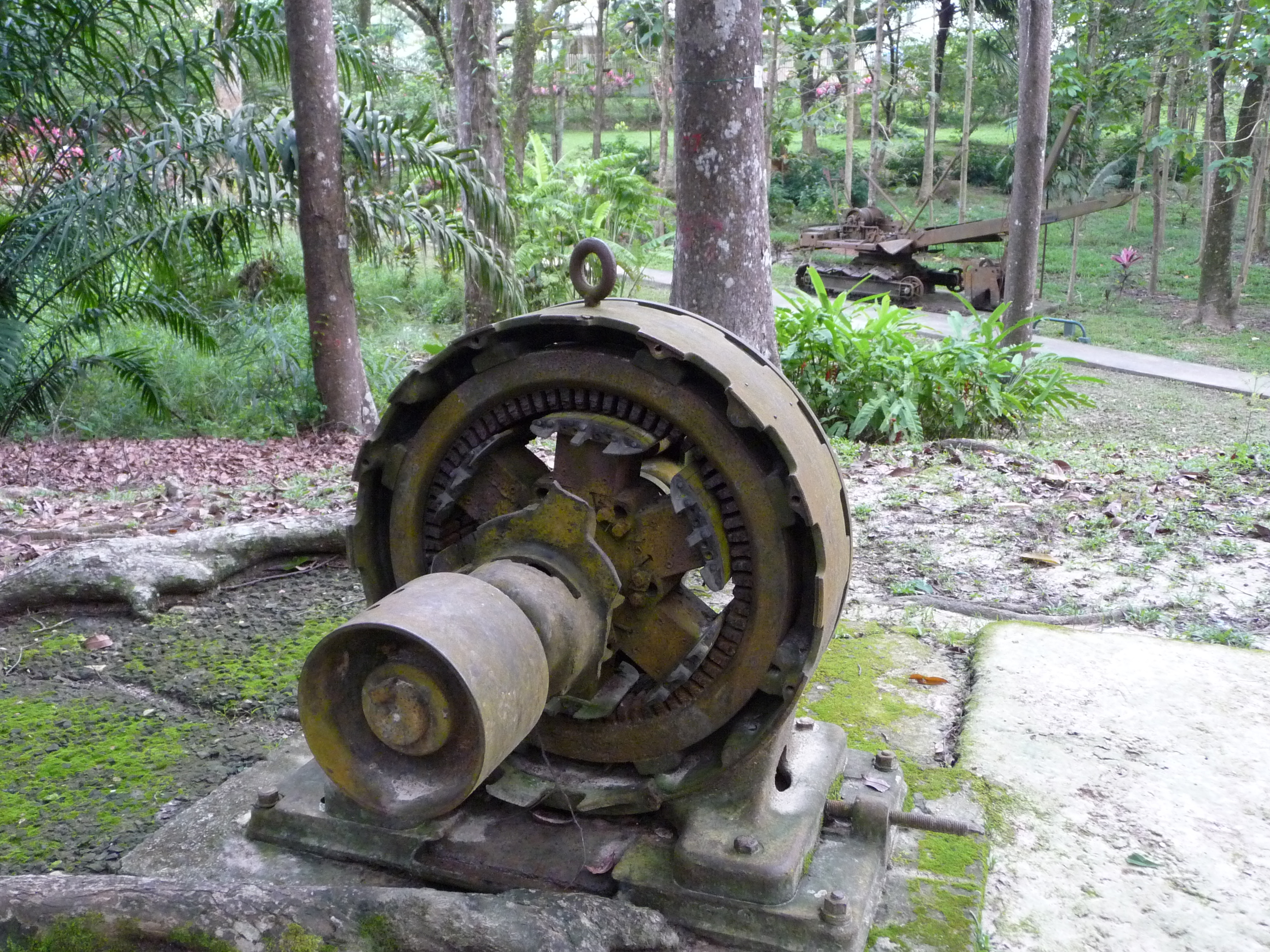 The silent remains of a generator, an excavator and other British-built equipment rest in the woods on the site of Sandakan PoW camp...